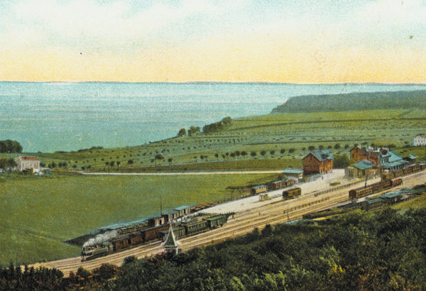 First, the train station was located on an open field, ca. 1905